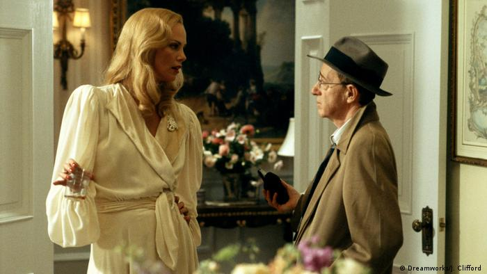 Charlize Theron and Woody Allen in The Curse of the Jade Scorpion from (Dreamworks/J. Clifford )