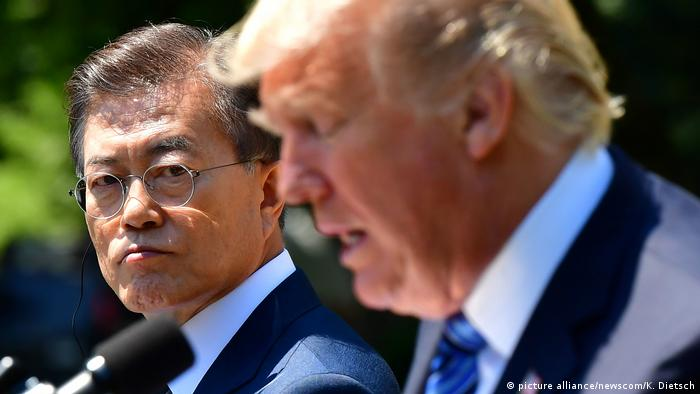 South Korean President Moon Jae-in watches as President Donald Trump speaks to the press