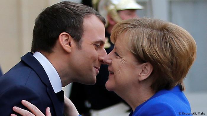 Macron and Merkel meet in Paris at the Elysee Palace