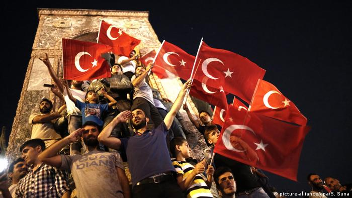 Turkey coup attempt, men holding Turkish flags