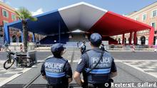 French municipal police officers stand by a tribune with the colors of the French flag ahead of the commemorations of the July 14 fatal truck attack on the Promenade des Anglais in Nice, France, July 12, 2017. REUTERS/Eric Gaillard