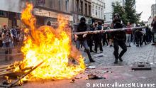 Black Bloc protesters behind fire in Hamburg during G20