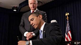 President Barack Obama signs executive orders during a meeting with senior staff, Wednesday, Jan. 21, 2009