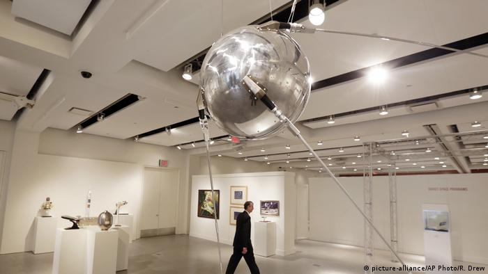 A full scale Custom Sputnik-1 model, above, to be offered at auction at Sotheby's, is displayed in New York
