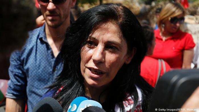 Khalida Jarrar speaks to reporters in Rammallah (Getty Images/AFP/A, Momani)