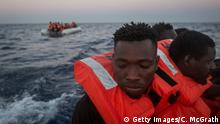 Refugees and migrants are seen in a rescue craft after being assisted from a small rubber boat by crewmembers from the Migrant Offshore Aid Station (MOAS) Phoenix vessel on June 10, 2017 off Lampedusa, Italy.(Getty Images/C. McGrath)