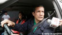 13.07.2017+++ Peruvian former president Ollanta Humala speaks to the press as he leaves his home next to his wife Nadine Heredia in Lima on July 13, 2017. Prosecutors in Peru have requested the arrest of former President Ollanta Humala and his wife Nadine Heredia on money laundering and conspiracy charges tied to a corruption scandal involving Brazilian construction company Odebrecht. / AFP PHOTO / STR (Photo credit should read STR/AFP/Getty Images)