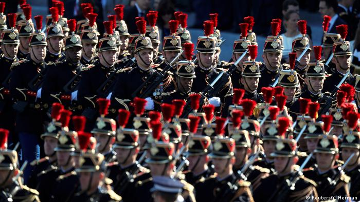 Members of the French Republican Guard march as they arrive for the traditional Bastille day military parade.