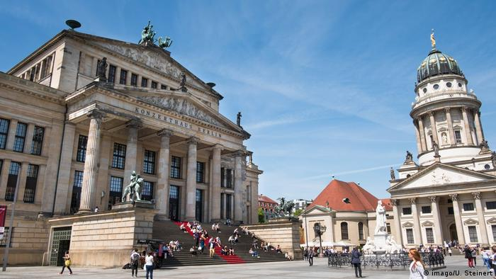 Summer sun warm temperatures lure Berlin and Tourists to stroll on the Gendarmenmarkt in Berlin
