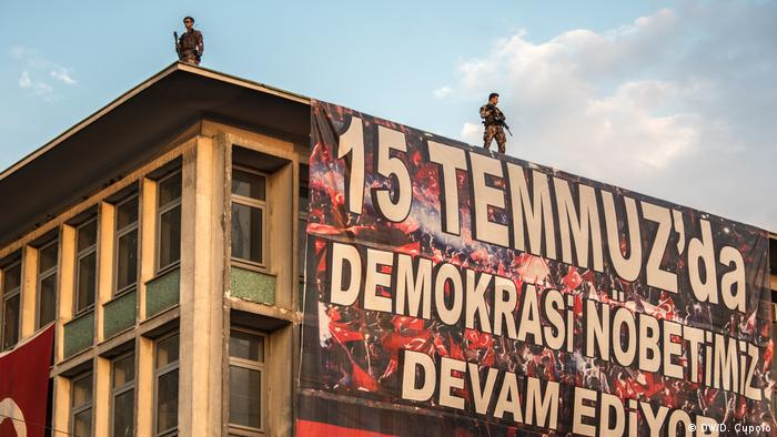 """Our Democracy Watch Continues"" reads a banner"