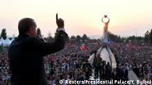 16.07.2017 *** Turkish President Tayyip Erdogan addresses his supporters during a ceremony marking the first anniversary of the attempted coup at the Presidential Palace in Ankara, Turkey July 16, 2017. Yasin Bulbul/Presidential Palace/Handout via REUTERS ATTENTION EDITORS - THIS IMAGE HAS BEEN SUPPLIED BY A THIRD PARTY. NO RESALES. NO ARCHIVES
