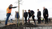 Dutch minister of Foreign affairs Bert Koenders (4nd L), Malaysia's Ambassador Ahmad Nazri Bin Yusof (C) and Tan Sri Mohamad Nor Yusof (3nd R), chairman of Malaysia Airlines, plant trees for the national monument in memory of the victims of the flight MH17 in Vijfhuizen on March 18, 2017. The Boeing 777 passenger jet was blown out of the sky on July 17, 2014 over war-torn eastern Ukraine killing all 298 on board, the majority Dutch citizens. / AFP PHOTO / ANP / Bas Czerwinski / Netherlands OUT (Photo credit should read BAS CZERWINSKI/AFP/Getty Images)