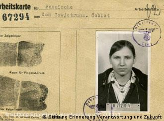 A work card showing a woman's picture and fingerprints