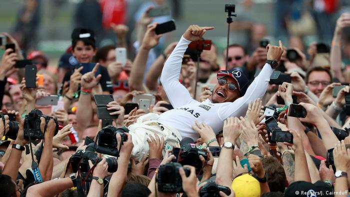 Silverstone, Britain - July 16, 2017 Mercedes' Lewis Hamilton celebrates his win with fans after the race (Reuters/J. Cairnduff)