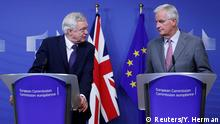 UK Secretary of State for Exiting the European Union David Davis (L) and the European Commission's Chief Brexit Negotiator Michel Barnier talk to reporters at the start of a first full round of talks on Britain's divorce terms from the European Union, in Brussels (Reuters/Y. Herman)