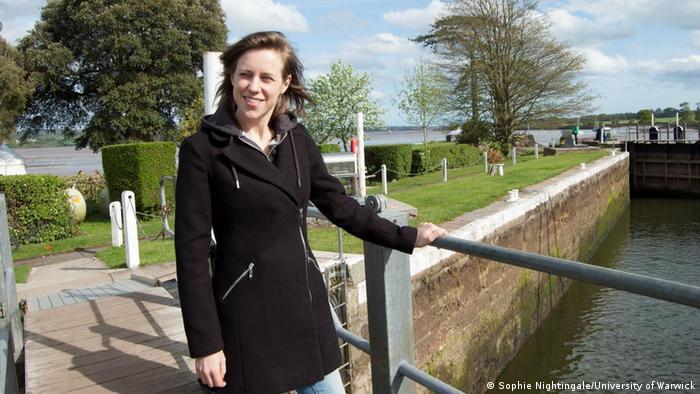 Photo of woman standing on bridge