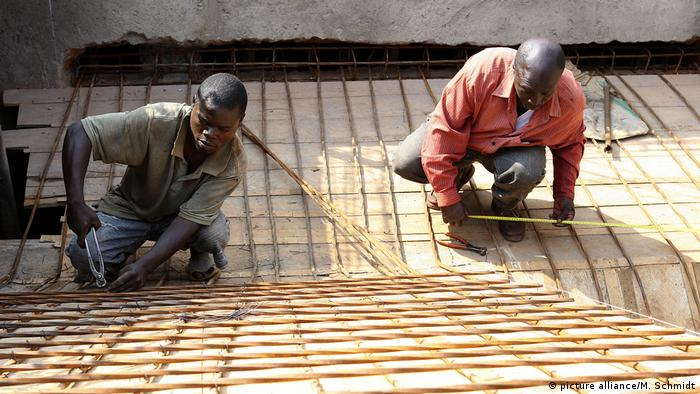 2 young men working on construction site