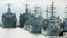 26 April 2004**** epa00179546 Minesweeping vessels from Malaysia (R), Thailand (C) and Singapore (rear) sit berthed at Changi Naval Base in Singapore on Monday 26 April 2004. Ships from the navies of Australia, Brunei, China, France, Indonesia, Japan, Malaysia, New Zealand, Philippines, Russia, Singapore, South Korea, Thailand, United States of America and Vietnam are here for mine countermeasure exercises in waters off the city-state. EPA/JONATHAN DRAKE  