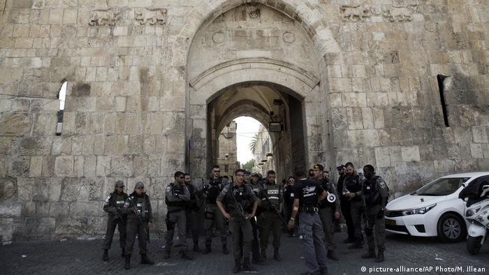 Israeli border police stand guard at the Lion's Gate in Jerusalem's Old City