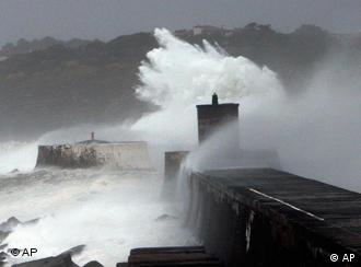 A huge wave hits a pier in southwestern France on Saturday, Jan 24