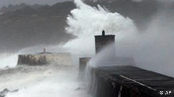 A huge wave hits a pier in southwestern France in January 2009, as a winter storm spreads