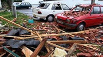Debris from buildings lies shattered in the street in southwestern France