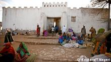People sit outside the walled city of Harar, Ethiopia, February 24, 2017. REUTERS/Tiksa Negeri SEARCH NEGERI HYENA FOR THIS STORY. SEARCH WIDER IMAGE FOR ALL STORIES.