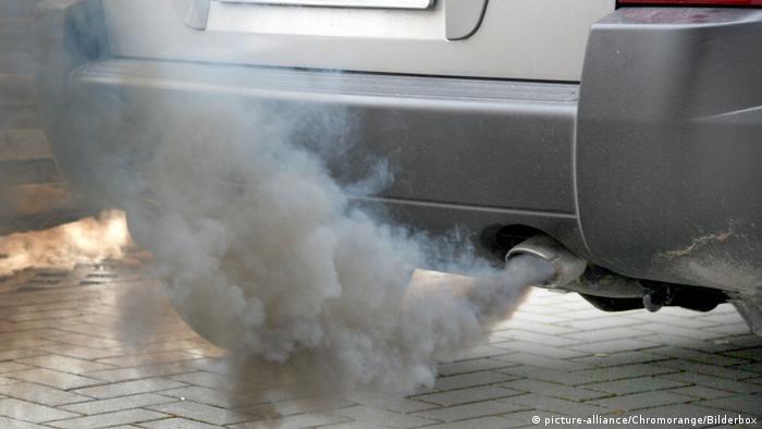 Exhaust pipe belching out grey smoke
