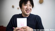 Japanese Shigetaka Kurita, the man who created emoji charachters, shows an emoji charachter after drawing during an interview with AFP in Tokyo on November 30, 2016. Kurita was working at major telecom NTT Docomo in 1999 when he sketched out one of the first emoji, a clunky looking thing barely recognisable as the precursor to today's yellow smiley face. From a humble smiley face with a box mouth and inverted V's for eyes, crude weather symbols, and a rudimentary heart -- emoji have now exploded into the world's fastest-growing language. / AFP / Behrouz MEHRI / TO GO WITH AFP STORY: Japan-culture-computers, INTERVIEW by Miwa Suzuki and Anne Beade (Photo credit should read BEHROUZ MEHRI/AFP/Getty Images)