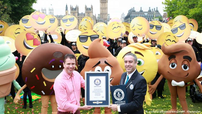 Vyv Evans, left, the UK's leading emoji expert, and Guinness World Records official adjudicator Jack Brockbank with people dressed as emojis (Photo: picture-alliance/empics/M. Alexander)