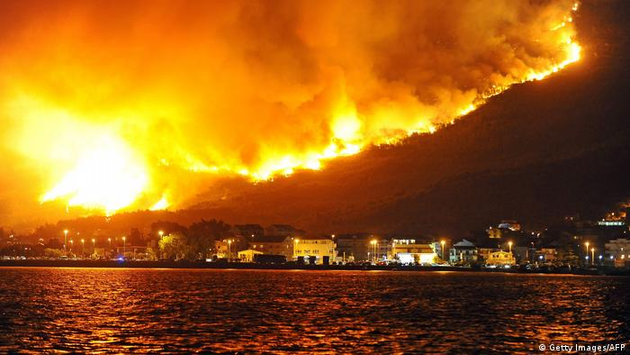 Smoke and flames rise from a fire in the village of Podstrana, near the Adriatic coastal town of Split, on July 18, 2017