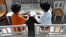 Two children put together puzzles