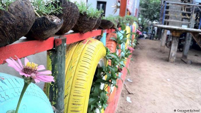 Photo: Colorful tires reused as flower pots, Coconut School, Cambodia. (Source: Koh Dach)