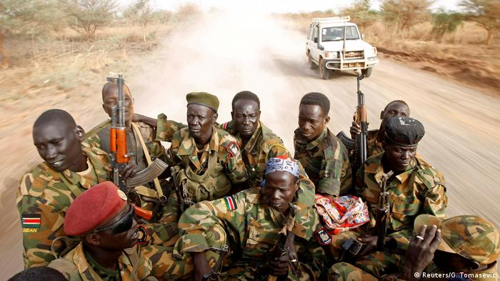 South Sudanese government soldiers sit in the back of a truck (Reuters/G. Tomasevic)