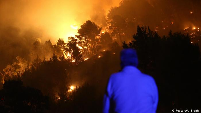 A man observes wildfire in the village of Mravince near Split, Croatia, July 17 (Reuters/A. Bronic)