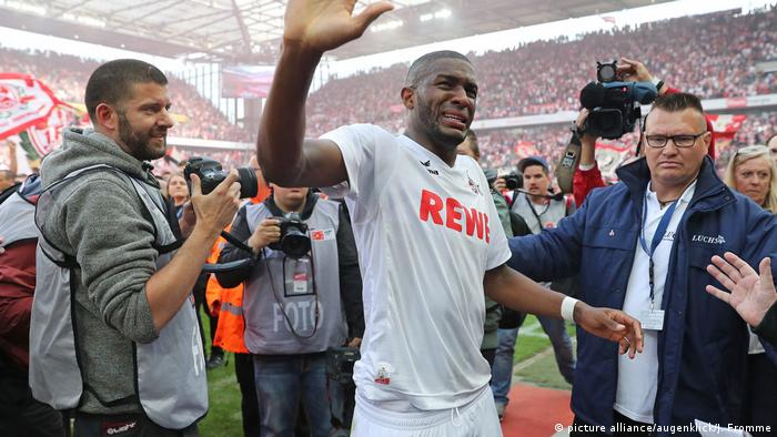 An emotional shot of Cologne striker Anthony Modeste, after May 12's Bundesliga game against Mainz. Cologne, its fans and Modeste celebrated qualifying for the Europa League after the game. Professional photographer Jörg Schüler is also in the shot, stood at Modeste's right shoulder.