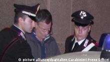 epa04512147 The alleged leader Massimo Carminati (2-R), a former member of the NAR neofascist terrorist group and of the Banda della Magliana crime gang, is arrested by Italian Carabinieri Rome, Italy, 02 December 2014, during an operation called 'Mondo di Mezzo' that involved also Former Rome mayor Gianni Alemanno under investigation with 100 people. Carminati allegedly recruited entrepreneurs for the racket and provided them with protection and also allegedly handled relations with other gangs, police officers, political and financial figures and even members of the secret services. EPA/ITALIAN CARABINIERI PRESS OFFICEI / HANDOUT BEST QUALITY AVAILABLE HANDOUT EDITORIAL USE ONLY/NO SALES  