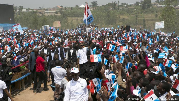 Rwandan presidential candidate Paul Kagame (C), the incumbent President of Rwanda, greets his supporters at a presidential campaign rally in Nyanza