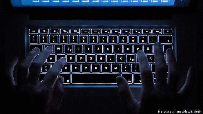 Picture of computer keyboard illuminated from below