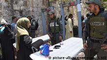 sraeli border police wait to screen Palestinian Muslims at a newly installed metal detector at a main entrance to the Temple Mount, also called Noble Sanctuary by Muslims, near the Lion's Gate in Jerusalem's Old City, July 16, 2017. Israeli security reopened the Temple Mount after installing added security measures, including metal detectors and cameras, after the holy site was closed since three Israeli Arabs killed two Israeli police officers in a shooting attack on Friday. The heads of the Jerusalem Islamic Waqf refused to enter the holy site through the Israeli metal detectors and organized a prayer outside the mosque compound. - Photo by Debbie Hill/UPI Photo via Newscom picture alliance |