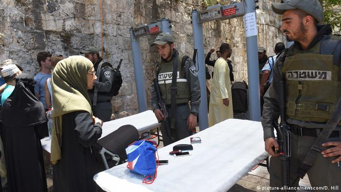 A Muslim woman goes through a new security checkpoint established at the entrance to the holy site in Jerusalem.