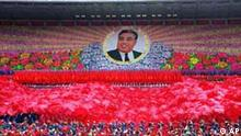 Thousands of North Korean children dance and hold up colored cards to form a picture of Kim Il Sung at a rally in Pyongyang, North Korea, on Friday, April 28, 1995. For outsiders, the personality cults that North Korea has built around late leader Kim Il Sung and his son and apparent heir, Kim Jong Il, are almost unimaginable in their slavishness. But for North Koreans, worshipping the Kims is as much a part of life as breathing. (AP Photo/John Leicester)