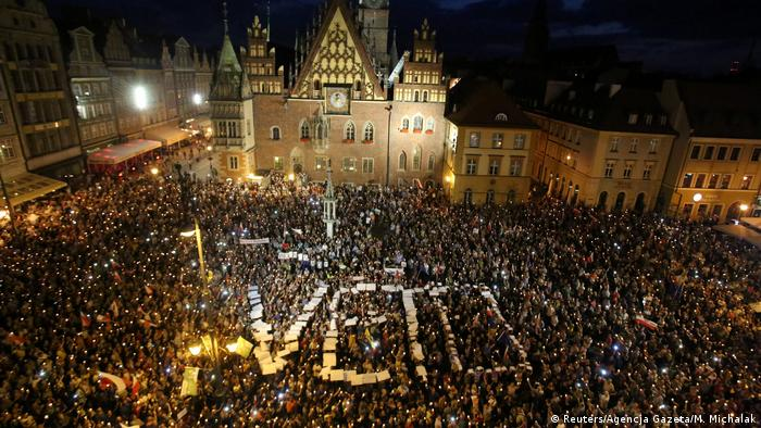 Tens of thousands of people gather in Wroclaw during a nighttime protest
