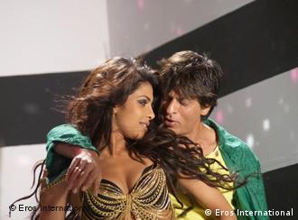 Bollywood actors Shah Rukh Khan and Priyanka Chopra embrace in a dance from one of their Bollywood films