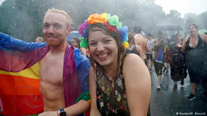 Wet revelers at the Christopher Street Day parade in Berlin, July 22 (Reuters/F. Bensch)