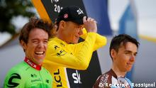 23.7.2017*** Cycling - The 104th Tour de France cycling race - The 103-km Stage 21 from Montgeron to Paris Champs-Elysees, France - July 23, 2017 - Cannondale-Drapac rider Rigoberto Uran of Columbia, Team Sky rider and yellow jersey Chris Froome of Britain and AG2R-La Mondiale rider Romain Bardet of France on the podium. REUTERS/Pascal Rossignol