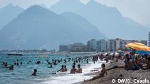 Beachgoers enjoy the sun in Antalya, Turkey