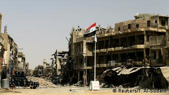An Iraqi flag is seen in Mosul