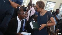 Tundu Lissu's lawyer Fatuma Karume consulting with other lawyers inside Kisutu court.