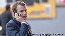French Economy and Industry minister Emmanuel Macron gives a phone as he visits the 2014 Paris Auto Show on October 3, 2014 in Paris on the second of the two press days. AFP PHOTO/MIGUEL MEDINA (Photo credit should read MIGUEL MEDINA/AFP/Getty Images)